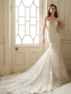 Sophia Tolli - Y11651 – Sultana - Misty tulle, diamond tulle and delicate allover lace with hand-beaded lace appliqués modified sheath bridal gown, slight cap sleeves, beaded Queen Anne neckline, sheer V-back bodice framed with lace appliqués and back zipper both trimmed with diamante buttons, scalloped hem lace, chapel length train. Also available with a 3 inch raised back neckline as Y11651HB.Sizes: 0 – 28Colors: Ivory/Champagne, Ivory, White