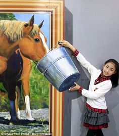 Art exhibition by popular 3-D artist Ai Weiwei in Hangzhou, China (2012), gets visitors involved in the art.