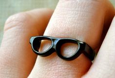 Mini-glasses as ring/jewelry.  Very cute.  Now if they just came in tortoiseshell.