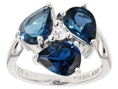 3.29ctw Pear Shape London Blue Topaz With .08ctw Round White Topaz Sterling Silver 3-stone Ring
