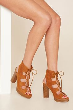 c0d7a74ccb07 A pair of faux suede platform sandals featuring a lace-up front with an open