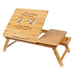 Handy desk for laptops with carvings for heat ventilation, a drawer, and space for snacks.
