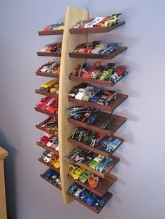 My youngest has tons of cars. This would be a great way to organize them as well as provide interesting wall art.