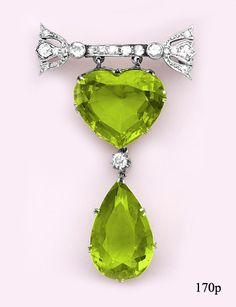 Heart-shaped peridot, pear-shaped peridot, diamond, and platinum brooch.