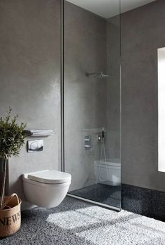 Love this style of bathroom. The tiles and how the toilet looks as though its floating.