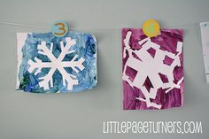 Tape and paint snowflakes.