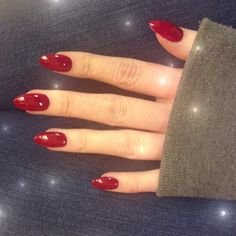 Pretty red manicured nails. Oval nails