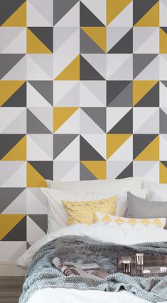 An enthralling, if not hypnotizing, design radiates from the Yellow & Grey Abstract Geometric Pattern Wallpaper. The countless squares almost glow with sophistication and metallic edge by virtue of the different combinations of the various tones of yellow and grey. #wallpaper #murals #wallmurals #interior #interiordesign #design #home #homedecor #interiordecor #accentwall #inspiration #Ihavethisthingswithwalls
