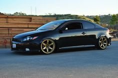 Scion tC on gold Rota Grid wheels