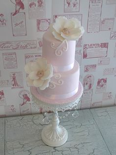 love the pink color! and the big flowers... maybe buttercream instead of fondant though