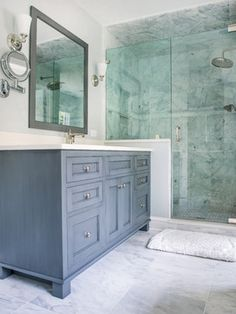gray vanity, frameless shower door