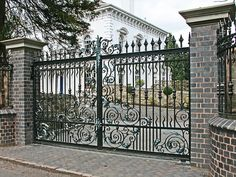 The Ultimate Driveway Gate Collection give home security in spectacular style. All gates can be customised to provide a truly unique design. Metal Driveway Gates, Metal Gates, Wrought Iron Fences, Wrought Iron Doors, Iron Gate Design, House Gate Design, Fence Design, Steel Railing Design, Tor Design