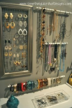 DIY Jewelry Wall ~ I used plastic canvas in frames (large for dangly/small for posts); wall mount tie rack for necklaces.