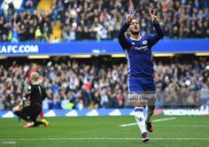 Eden Hazard of Chelsea (R) celebrates scoring his sides second goal during the Premier League match between Chelsea and Leicester City at Stamford Bridge on October 15, 2016 in London, England.