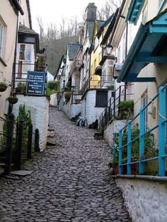 Clovelly, England. Get here early enough so you can ride a donkey down into the village. I LOVE the cobblestone streets but they can hurt your feet after a bit of walking.
