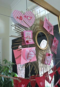 Great way to display your Valentine's Day cards - starburst mirror hung with Command(TM) Sticky Nail Wire-Baked Hanger