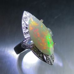 3.20ct Natural Welo rainbow Opal & topaz 925 sterling silver ring all sizes £316.00