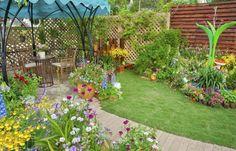 23. Backyard Garden With Sitting Area