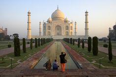 Visitors taking photos of Taj Mahal.