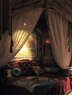 I like the drapes, it would be a cool way to close in the loft without making something very solid or restricting