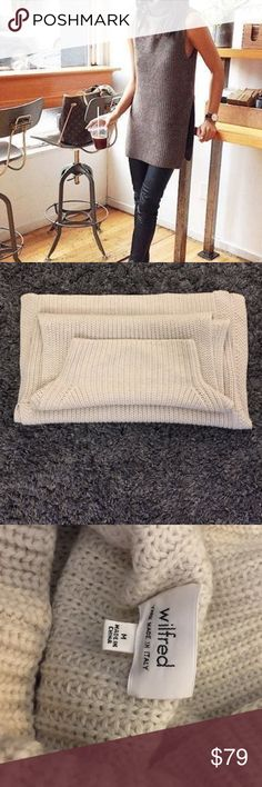 """Cream Sleeveless Turtleneck Sweater by Wilfred 32"""" in length. Slits on both sides, 13"""" from the bottom. Great to wear as a sleeveless sweater, or throw a tight long sleeved shirt underneath. In great condition. Aritzia Sweaters Cowl & Turtlenecks"""