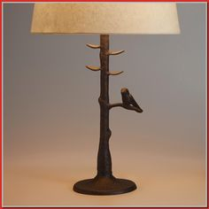 Bring a touch of the outdoors inside with our Woodlands Table Lamp Base. Its aluminum base features a bronze powder-coated finish and realistic texture, not to mention an adorable bird perched on the Table Lamp Shades, Table Lamp Base, Lamp Bases, Home Design, World Market Table, Unique Front Doors, Stainless Steel Kitchen Faucet, Tall Lamps, Kitchen Remodel Cost