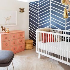 The Animal Print Shop Nursery Project. Sweet baby boy's nursery design with Navy blue chevron accent wall and Confetti System Tassel Garland over Oeuf Sparrow Crib. The Animal Shop Camel Print paired with coral Dorothy D Navy Nursery, Nursery Modern, Girl Nursery, Modern Nurseries, Nursery Room, Neutral Nurseries, Modern Crib, Girl Room, Modern Kids