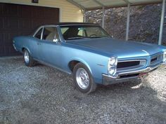 My dad had this car when I was just a little kid!  I can still remember what the inside of that old car smelled like and what the dashboard looked like. Makes me miss him.  He loved this car. 1966 Pontiac Tempest 2dr