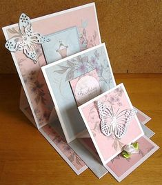 handmade greeting card ... Triple Stacked Easel Card from docrafts.com ... die cut butterflies and stamped flowers ... sky blue and baby pink ... sweet!