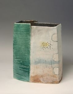 This is a large slab built vessel by Craig Underhill which he has decorated with incised lines, engobe, underglaze and glazed.