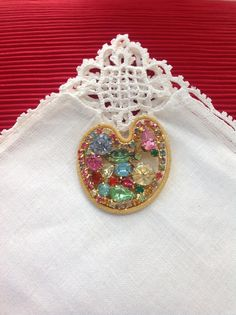 Listed is a signed Weiss fruit salad rhinestone brooch. Fruit salad jewelry contains rhinestones or molded stones that are shapes of fruit or