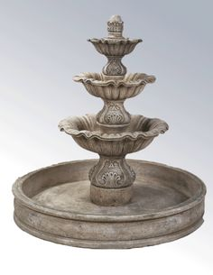 What a lovely three tier fountain to add to your beautiful garden setting. Sure to make a stunning focal point, each tier features a scalloped design, while the column part features beautiful and ornate detailing. Different from the Regina Three Tier Fountain, this beautiful fountain is placed inside of a basin, allowing the Regina Three Tier Fountain in Basin to be the center piece for your backyard or business! The Regina Three Tier Fountain in Basin adds a classical sophistication to your