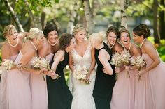 Love this spin on mismatched bridesmaid dresses with a blush and black color palette.