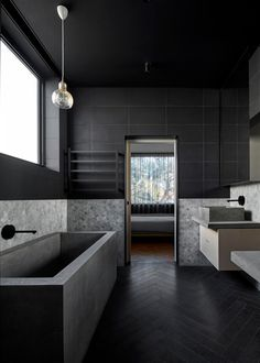 Get the Look: Statement Bathrooms | Bathroom in the Writer's House by Branch Studio Architects | Black details