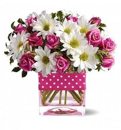 For a special treat that can't be beat, this cheery blend of white daisies and pink roses is a gift that always inspires a smile. White daisy spr ...