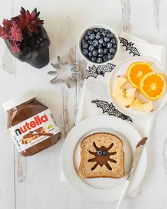 Create a special Halloween breakfast for your family with Nutella! Directions: Using a spider-shaped cookie cutter, cut out the middle of a piece of whole wheat bread. Spread Nutella on a second slice of bread. Place the slice with the spider cut-out on top. Place two blueberries to make spider eyes. Serve along with pumpkin-shaped orange slices and bat-shaped apple slices for extra Halloween fun! (Credit: @whiteblankspaceblog) Apple Slices, Orange Slices, Halloween Breakfast, Nutella Spread, Hazelnut Spread, Whole Wheat Bread, 31 Days Of Halloween, Shaped Cookie, Slice Of Bread
