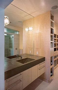This bathroom/closet is an interesting take on the open shelving trend.