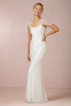 Snowflake Gown BHLDN: A plunging back reveals an elegant glimpse of skin, while thousands of intricate, iridescent beads float down the flutter sleeves, then cascade to the floor-length hem. #wedding #prom #beads