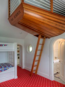 Boat hull used as an indoor treehouse for a kid's room. Genius.