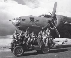 Air crew posing on Jeep in front of B-17F 'Our Gang' of 324th BS 91st BG US 8th Air Force Bassingbourn England United Kingdom 15 June 1943.