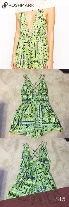 Green Aztec Romper Asos green Aztec printed romper. Low cut front with lattice cut out detail. Cross back straps. Size 0 ASOS Other