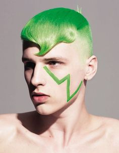 green hair, so uncommon, but i think it looks good on him, its all about the attitude.