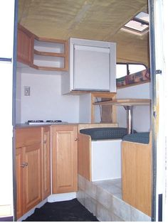 Great horse trailer LQ conversion on a 4 ft short wall.  Holding and water tanks are under dinette so no worries of ground clearance.
