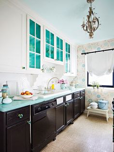 We love the use of different shades of blue in this stylish kitchen! More kitchen ideas: http://www.bhg.com/kitchen/cabinets/makeovers/low-cost-kitchen-cabinet-makeovers/?socsrc=bhgpin052413bluecounter=13
