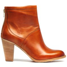 SIENNA   Midas Ankle boots are a must-have for every wardrobe and this heeled option from MIDAS is sure to be a firm favourite in yours. Crafted in Italy and made from beautifully soft leather, they feature an almond toe, stacked heel and a back zip for easy entry. Wear yours now with skinny jeans and an oversized knit. Heel height is 8cm. Made in Italy.