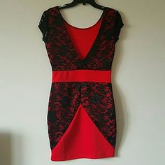 FINAL PRICE  Flattering Red / Black lace dress NWOT!!  Silhouette flattering evening dress with a deep plunge line. Eye catching red with a black mesh lace overlay on both front and back.  Red ribbon banding around the waistline. Beautiful detail, must try to appreciate it. Can accommodate a S/M figure.  Smoke free / pet free home Dresses Midi