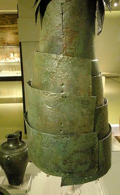 Ancient Panoply The Dendra Panoply is a set of bronze armor discovered in the Mycenean tombs near the village of Dendra (Greece) dated to the fifteenth century BC. With a weight of 15kg which was probably higher on its origin, it is not exactly a light armor.