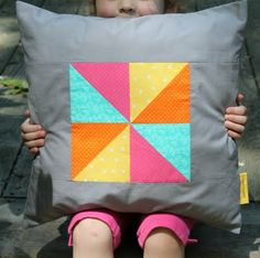 Summer Pinwheel Pillow tutorial.  so simple but bold and fun. thinking of using fabric from the Washi line.