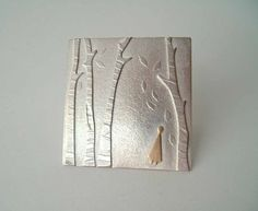 Beneath four birch-silver and 9c gold brooch