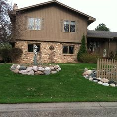 great front yard with statue and stone details